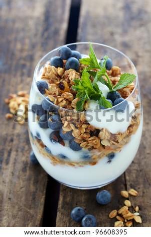 Healthy Breakfast of Natural yogurt with berries and muesli - stock photo