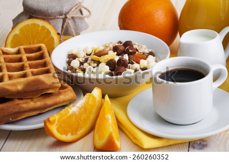 Healthy breakfast of oatmeal,coffee, wafers ,fresh juice, jam and oranges on a wooden background - stock photo