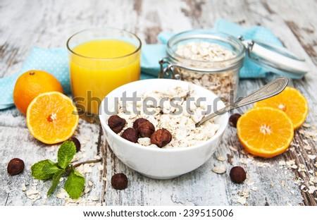 Healthy breakfast - orange juice  and muesli with nuts - stock photo