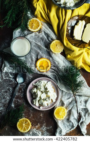 Healthy breakfast product concepts. Homemade  cottage cheese.Healthy and diet food concept. Rustic style. Top view. Plate of homemade cottage cheese. Dark rustic atmosphere. - stock photo