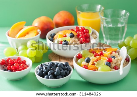 healthy breakfast quinoa with fruits berry nectarine blueberry grape - stock photo