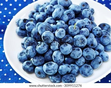 Healthy breakfast with berries on textile background  - stock photo