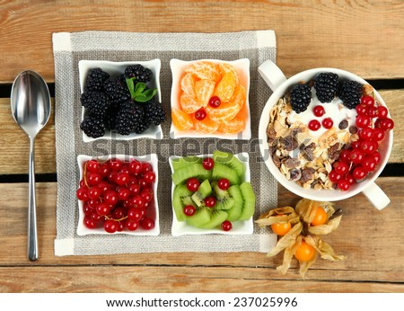 healthy breakfast with corn flakes and fruits - stock photo