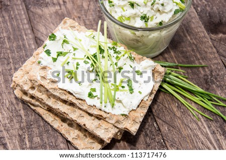 Healthy breakfast with Crispbread and Cream Cheese an wood - stock photo