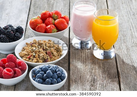healthy breakfast with fresh berries on wooden background, horizontal, close-up - stock photo