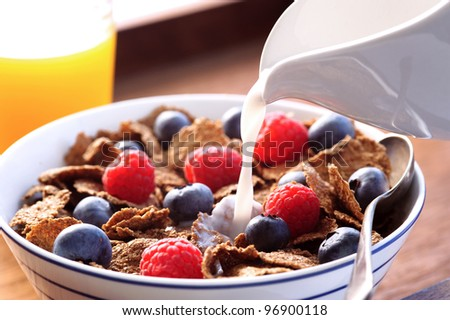 Healthy breakfast with milk and fresh fruit - stock photo