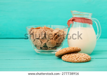 Healthy breakfast with muesli and milk. View from above on wooden table with copy space. selective focus - stock photo