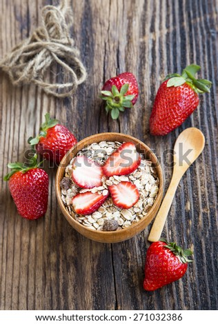 Healthy Breakfast with Muesli and Strawberry Fruits in a Bowl - stock photo