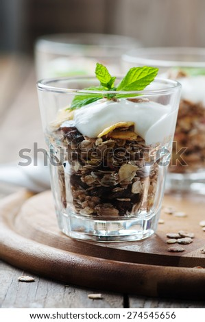 Healthy breakfast with muesli and yogurt, selective focus - stock photo