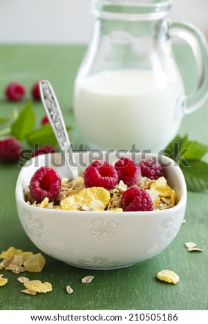 healthy Breakfast with raspberries and granola