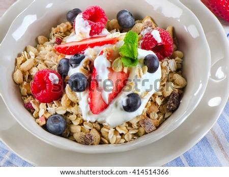 Healthy Breakfast with ripe  berries, yogurt , muesli. Selective focus - stock photo