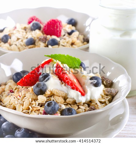 Healthy Breakfast with ripe fresh berries and  muesli. Selective focus - stock photo