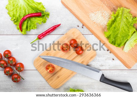 Healthy breakfast with tomato, toasts, meat and salad on wooden table - stock photo