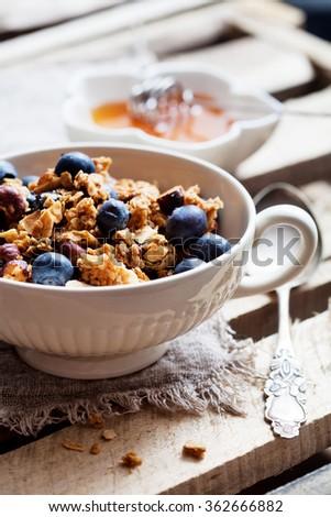 Healthy breakfast with yogurt, granola and fresh berries - stock photo