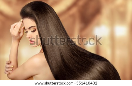 Healthy Brown Hair. Beauty Model girl. Beautiful brunette woman with long smooth shiny straight hair. Hairstyle. Hair cosmetics, haircare. Hair care, extensions. - stock photo