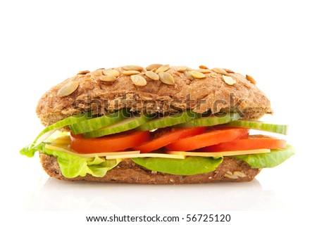 Healthy brown sandwich with cheese and vegetables - stock photo