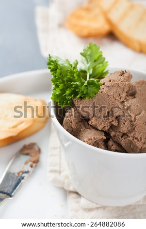 Healthy chicken liver pate with parsley in bawl,  selective focus - stock photo