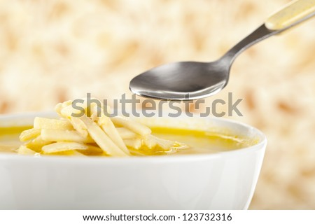Healthy Chicken Noodle Soup on bowl with spoon - stock photo