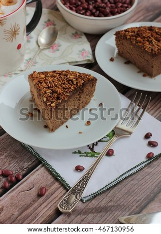 healthy chocolate cake with beans on a wooden background