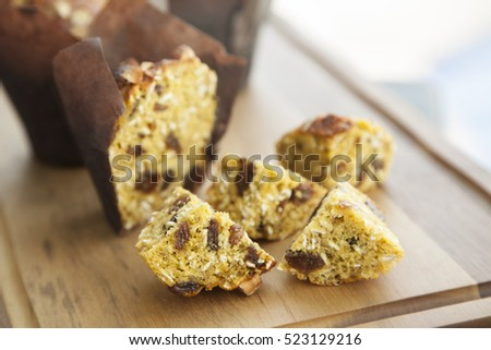 Healthy choice of banana and oat muffin with roasted almond flakes on top.