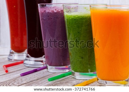 Healthy Colorful Smoothies with Fruits and Vegetables Against a Rustic Wooden Background. Various Freshly Squeezed Juices for Detox - stock photo