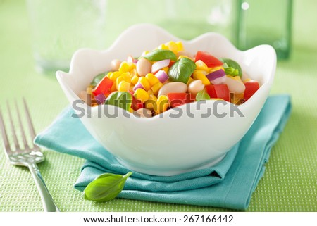 healthy corn salad with tomato onion white bean basil - stock photo