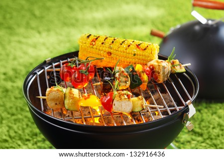 Healthy corncob en brochette on the grill outdoor - stock photo