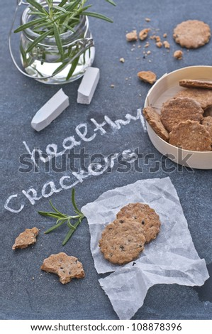 Healthy crackers with black sesame and rosemary - stock photo