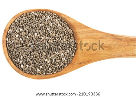 Healthy dark chia seeds in wooden spoon isolated on white - stock photo