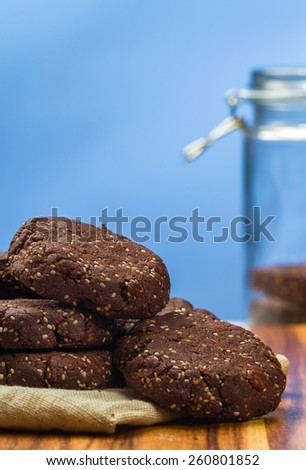 Healthy dark chocolate, almond chia seed cookies and cookie jar - stock photo