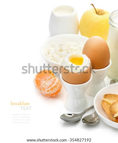 Healthy delicious breakfast, soft-boiled eggs in the stands, toast with cheese, cottage cheese, apple, tangerine, cream on a white background, the concept of a balanced diet, diet