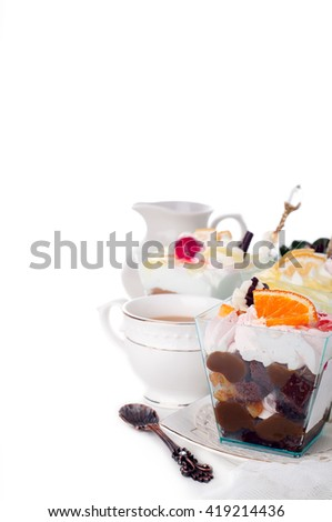 Healthy  dessert with creamy yoghurt layered with pure and fresh fruit in a glass - stock photo