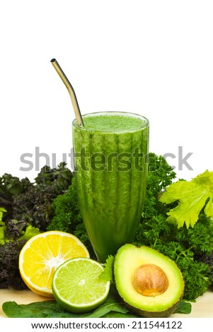 Healthy detox raw green vegetable smoothie leafy greens, spirulina and citrus - stock photo