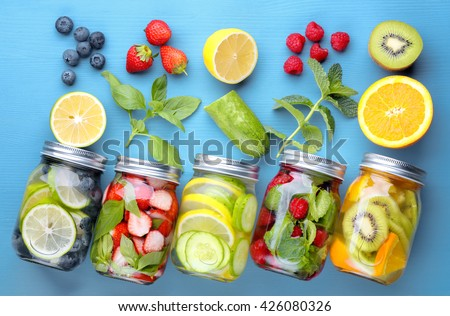 Healthy detox water with fruits.... - stock photo