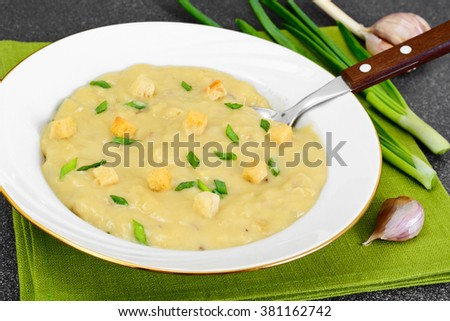 Healthy, diet food: Cream soup with mushrooms and vegetables with croutons and herbs. Studio Photo