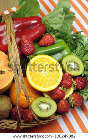 Healthy diet - sources of Vitamin C - oranges, strawberry, bell pepper capsicum, kiwi fruit, paw paw, spinach dark leafy greens and parsley. Vertical. - stock photo