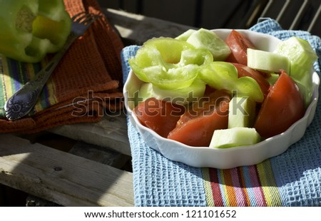 Healthy dinner: green salad with tomatoes and cucumber