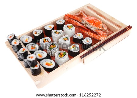 healthy dinner Maki Roll with Deep Fried Vegetables inside . on wooden plate with live crab . isolated over white background . Japanese Cuisine