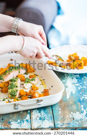 Healthy dish with parsley pesto and fresh salmon fillet - stock photo