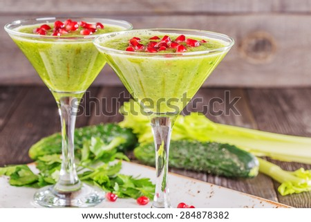Healthy drink, vegetable smoothie on a wooden background in a rustic style.