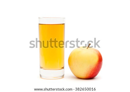 Healthy eating and a healthy lifestyle . Apple with a glass of apple juice on a white background isolated .