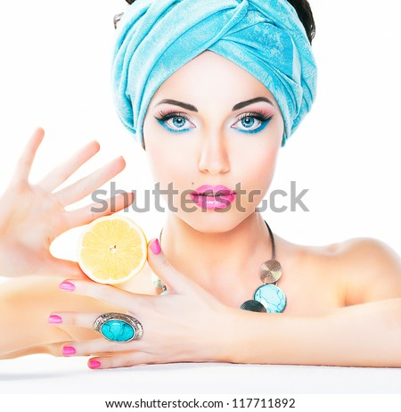 Healthy Eating and Health Care Concept. Nutrition and Dieting. Beauty sexy Woman holding Fresh Lemon. Clean Smooth Natural Skin. - stock photo