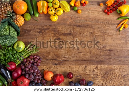 Healthy eating background / studio photography of different fruits and vegetables on old wooden table
