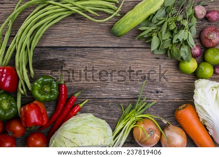 Healthy eating background / studio photography of different vegetables on old wooden table - stock photo