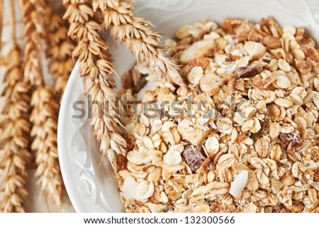 Healthy eating breakfast low calories bowl of swiss muesli. Above point of view, closeup - stock photo