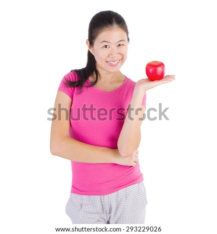 Healthy Eating Concept.Asian girl holding an apple. Isolated over white background. - stock photo