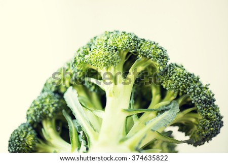 healthy eating, diet, vegetarian food and culinary concept - close up of broccoli over white