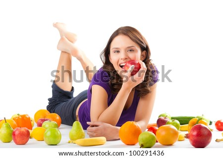 Healthy eating, happy woman with fruits and vegetables is eating a apple