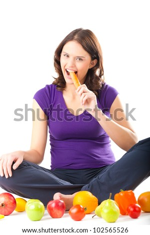 Healthy eating, happy woman with fruits and vegetables is eating a carrot - stock photo