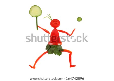 Healthy eating. Little funny tennis-player made ??of pepper. - stock photo